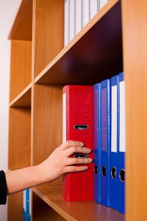 Woman s hands with folders at office photo