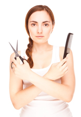 Hairdresser holding a  scissors and comb smiling isolated on white Stock Photo - 17492513