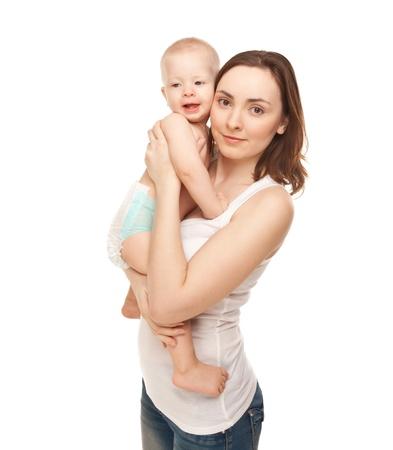 angeles bebe: Foto de la madre feliz con el beb� adorable aislado en blanco Foto de archivo