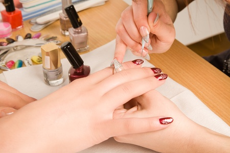 nailcare: Woman with nail brush drawing on nails