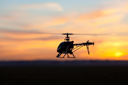 Picture of helicopter at sunset Stock Photo