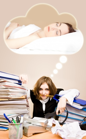 appointee: Tired businesswoman with telephones and pen in her mouth sitting and dreaming of a sleep Stock Photo