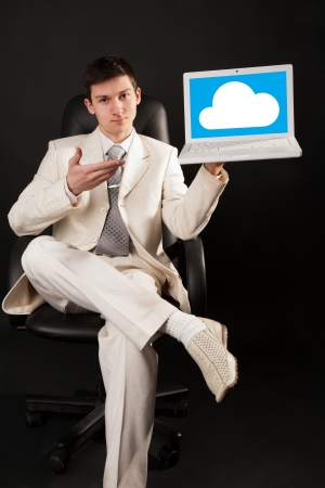 Young man presenting a cloud pltform with notebook photo