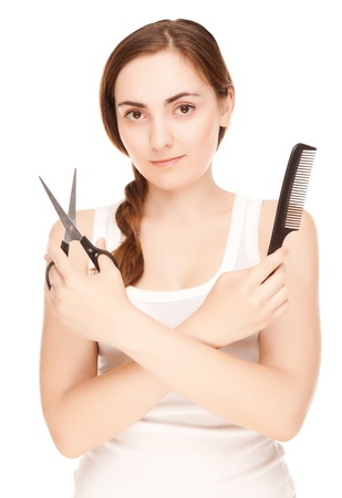 Hairdresser holding a  scissors and comb smiling isolated on white photo