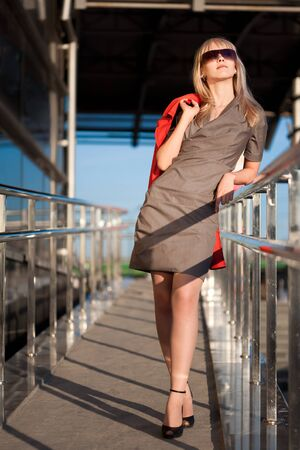 Beautiful woman standing on the shop and thinking Stock Photo - 18623007