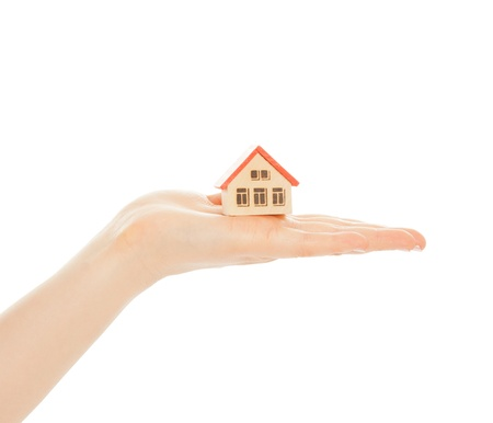 Woman s hands with toy house isolated on white Stock Photo - 19708074