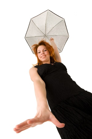 Red haired woman in black dress with umbrella looking down photo