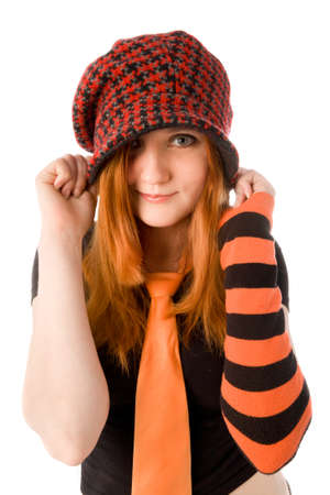 Red haired girl in knit hat isolated on white photo