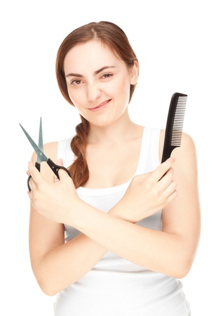 Hairdresser holding a  scissors and comb winking isolated on white photo