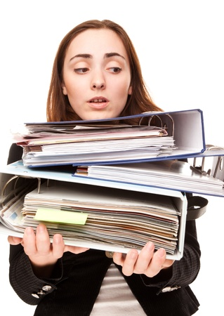 Young secretary in stressed with a ton of documents in folders photo