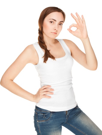 Beautiful woman in white vest giving okay sign isolated on white Stock Photo - 19977917