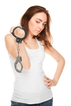 Beautiful woman with handcuffs isolated on white photo