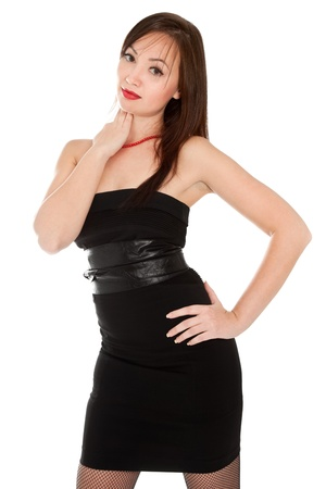 Beautiful woman with red lips in little black dress isolated on white photo