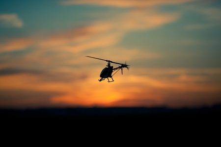 rc: Photo of an RC copter flying at sunset
