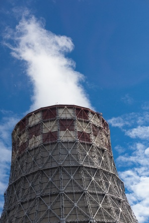 Power plant with huge cooling towers against blue sky Stock Photo - 20580879