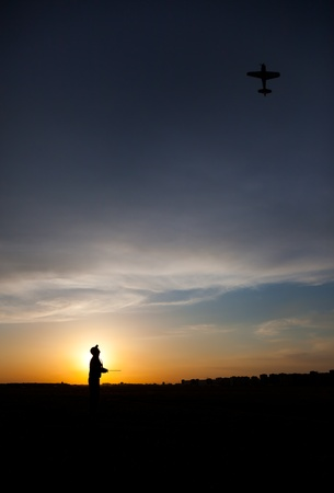 rc: Man silhouette with rc plane (focus on RC model)