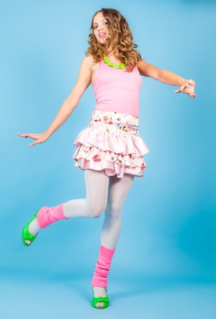 Beautiful woman in pink clothers dancing at studio photo