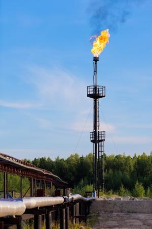 Burning oil gas flare photo