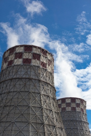 npp: Power plant with huge cooling towers against blue sky Stock Photo