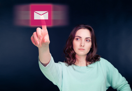 Woman pointing her finger to virtual button Stock Photo - 22268052