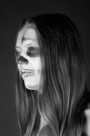 Portrait of scary zombie woman photo