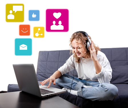 Beautiful woman in headphones communicate with people by means laptop Stock Photo - 22794885