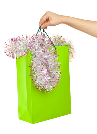 spangle: Picture of woman s hand with green shopping bag and spangle Stock Photo