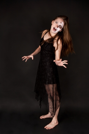 Scary zombie woman in black dress photo