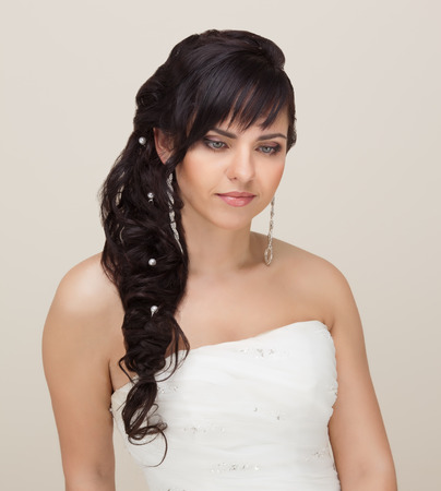 Picture of beautiful bride with make-up and hairstyle photo