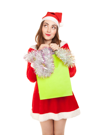 Picture of dreaming woman in costume with new year shopping bag photo