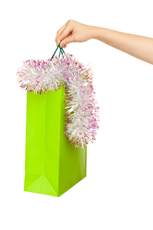 woman s bag: Picture of woman s hand with green shopping bag and spangle Stock Photo