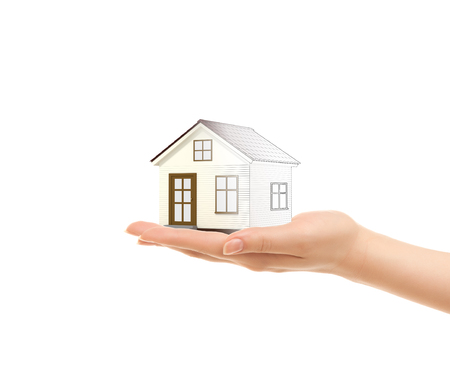 Picture of womans hands holding a house isolated on white photo