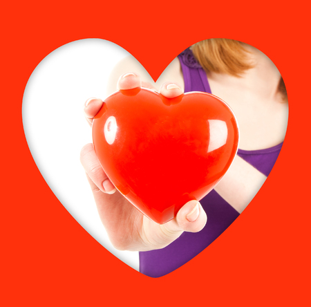 Woman hand with red heart isolated on white photo