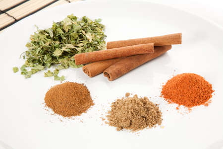 Plate with different spices on the table photo