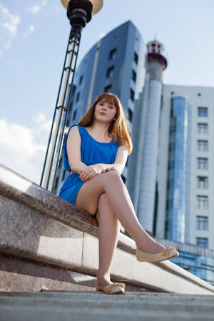 Beautiful woman in blue dress outdoors photo