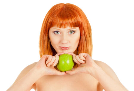 Beautiful ginger-haired woman with green apple isolated on white photo