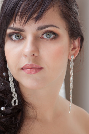 Portrait of beautiful bride with make-up photo