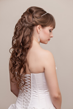 Picture of beautiful bride with wedding hairstyle photo
