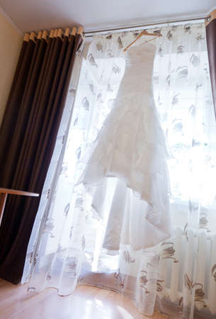 hanged: Picture of wedding white dress hanged Stock Photo