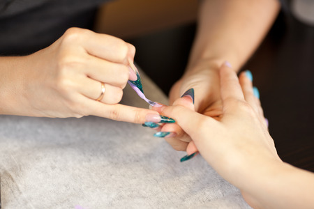 nail studio: Picture of woman at manicure procedure at nail studio