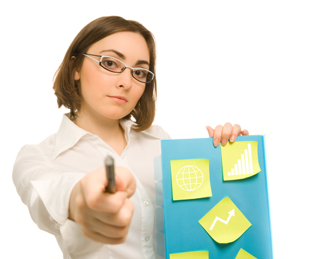 Picture of a young secretary holding a folder with stickies and pointing to camera