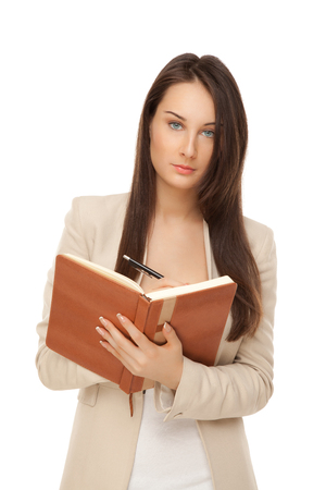 Picture of young businesswoman with notebook and pen isolated on white