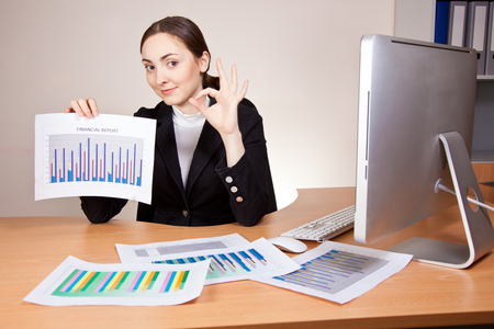 Businesswoman with financial reports at the office photo