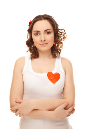 Woman with a pinned red paper heart isolated on white Stock Photo