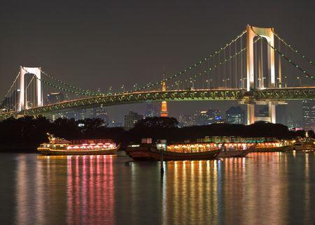 Night shot of the Rainbow Bridge in Tokyo photo