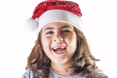 smiling little girl with hat of Santa Claus Stock Photo