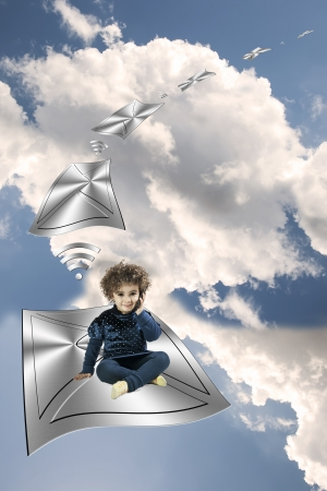 child on the phone over an envelope flying driven by wi-fi network photo
