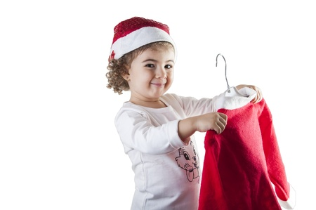 little girl dressed in Santa Claus in hand photo