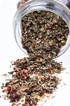 jar of chopped spices and pour over white background Stock Photo - 16992731