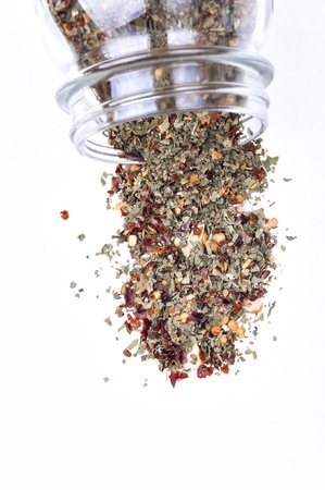 jar of chopped spices and pour over white background Stock Photo - 16992728